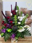 Tropical and contemporary flowers in tall vase